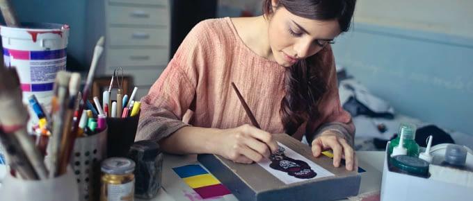 Graphic Designer creating a logo at her desk